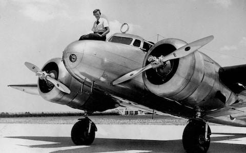 This 1937 photo shows Amelia Earhart before takeoff in Miami for her attempted round-the-world flight - Credit: AP