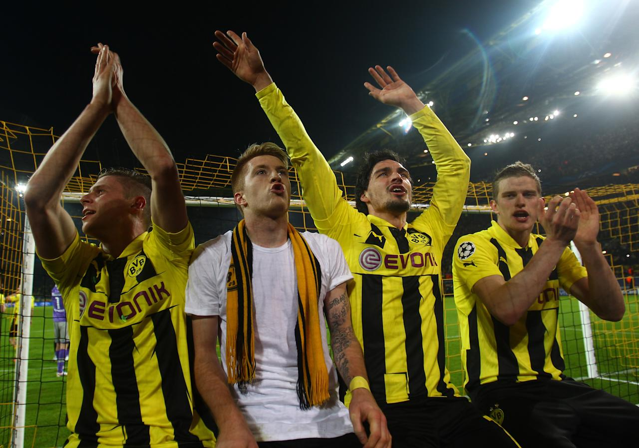 DORTMUND, GERMANY - APRIL 09:  Lukasz Piszczek, Marco Reus, Mats Hummels and Ilkay Gundogan of Borussia Dortmund celebrate victory and a place in the semi-finals in the UEFA Champions League quarter-final second leg match between Borussia Dortmund and Malaga at Signal Iduna Park on April 9, 2013 in Dortmund, Germany.  (Photo by Alex Grimm/Bongarts/Getty Images)