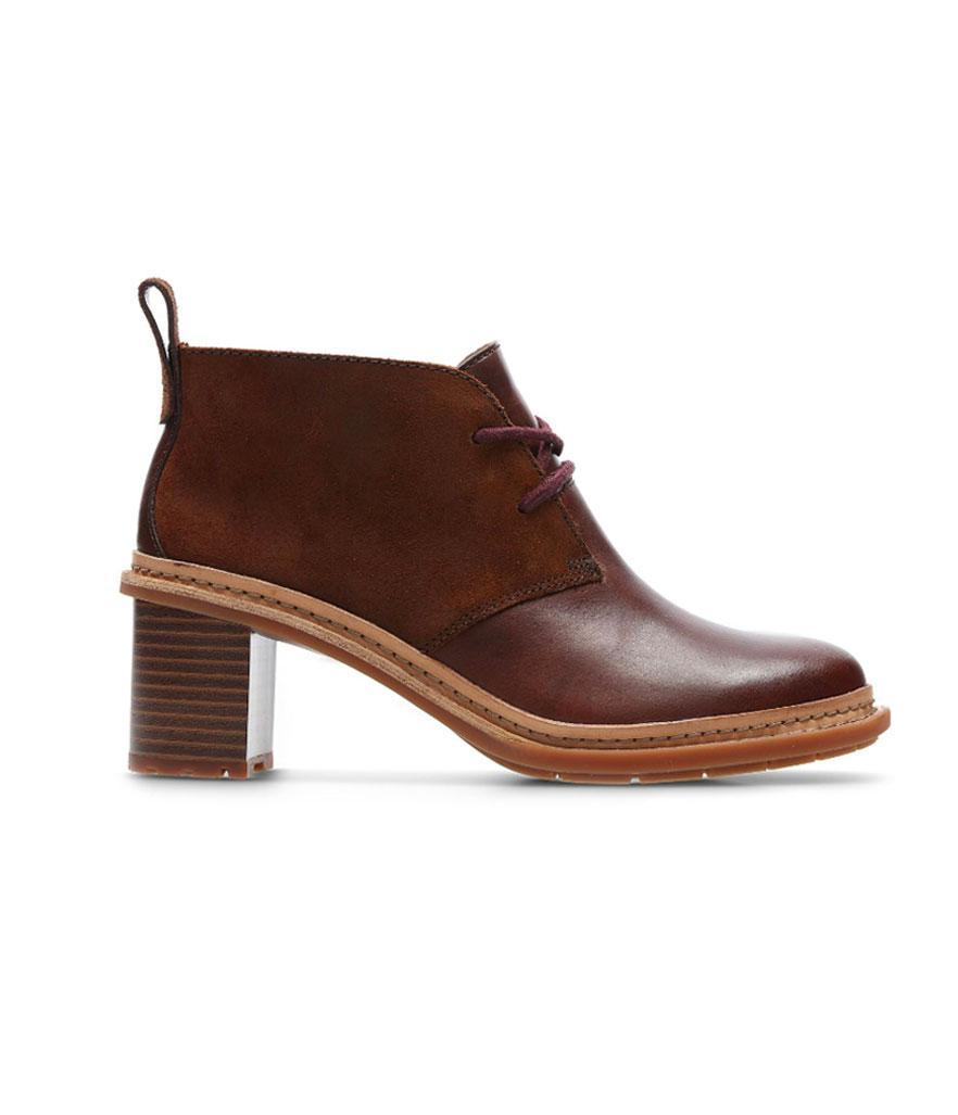 """<p>In dark mahogony, these boots have a 2.3-inch stacked heel and Clarks's special """"Cushion Plus"""" technology for added comfort. <br><a href=""""https://fave.co/2qsUTMi"""" rel=""""nofollow noopener"""" target=""""_blank"""" data-ylk=""""slk:Shop it:"""" class=""""link rapid-noclick-resp"""">Shop it:</a> Trace Glow Women's Boots, $140, <a href=""""https://fave.co/2qsUTMi"""" rel=""""nofollow noopener"""" target=""""_blank"""" data-ylk=""""slk:clarkusa.com"""" class=""""link rapid-noclick-resp"""">clarkusa.com</a> </p>"""