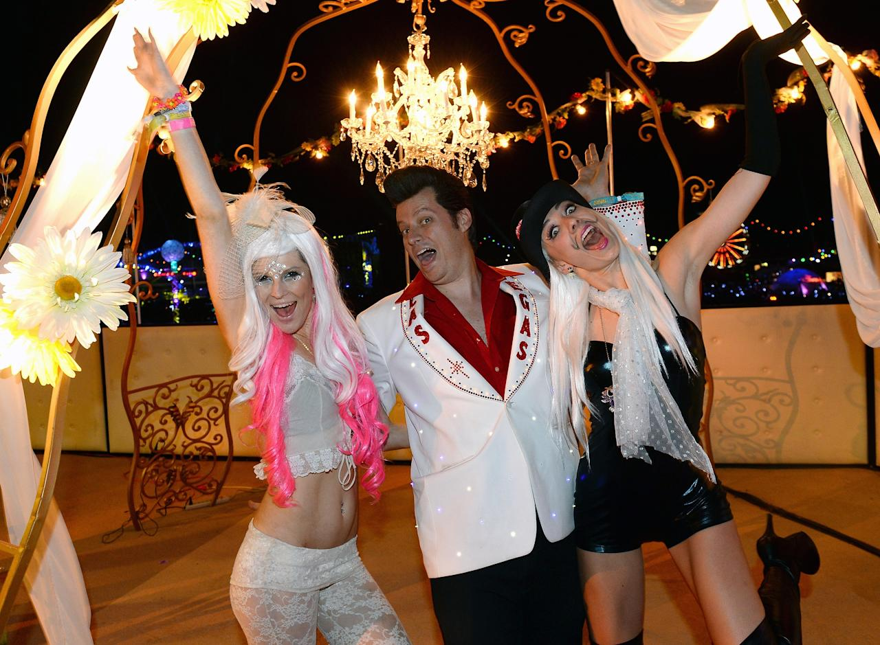 LAS VEGAS, NV - JUNE 23: Elvis Presley impersonator Brian Mills (C) poses with Jessica O'Donnell (L) and Adele Vannini (R) after he performed their commitment ceremony at the 17th annual Electric Daisy Carnival at Las Vegas Motor Speedway on June 23, 2013 in Las Vegas, Nevada. (Photo by Ethan Miller/Getty Images)