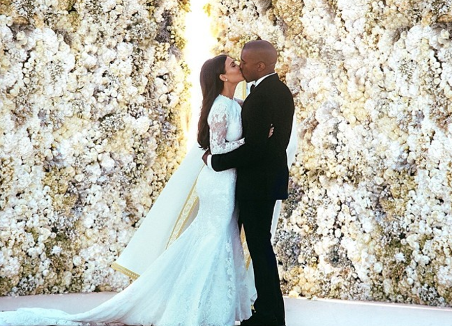 "<p>Kim Kardashian and Kanye West <a href=""https://www.popsugar.com/celebrity/Kim-Kardashian-Kanye-West-Wedding-Facts-43470534"" rel=""nofollow noopener"" target=""_blank"" data-ylk=""slk:married"" class=""link rapid-noclick-resp"">married</a> in a 16th-century-era fortress in Florence, Italy, in May 2014. They exchanged vows in front of a flower wall as a backdrop, and there were also no E! cameras at the ceremony. </p>"