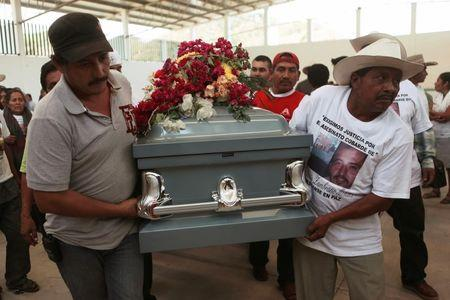 Relatives of Antonio Zambrano-Montes carry his coffin after a funeral mass in Pomaro, in the Mexican state of Michoacan March 7, 2015.   REUTERS/Alan Ortega