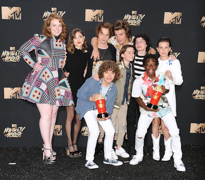 (L-R) Actors Shannon Purser, Natalia Dyer, Charlie Heaton, Gaten Matarazzo, Caleb McLaughlin, Noah Schnapp, Finn Wolfhard, Joe Keery and Millie Bobby Brown of 'Stranger Things' pose in the press room at the 2017 MTV Movie and TV Awards at The Shrine Auditorium on May 7, 2017 in Los Angeles, California.