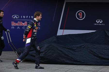 Red Bull Formula One driver Vettel of Germany walks before unveiling the new RB10 at the Jerez racetrack in southern Spain