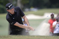 Keegan Bradley hits from a bunker onto the third green during the final round of the Valspar Championship golf tournament, Sunday, May 2, 2021, in Palm Harbor, Fla. (AP Photo/Phelan M. Ebenhack)