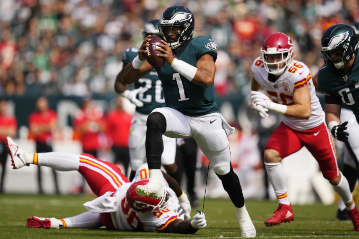 FILE - Philadelphia Eagles quarterback Jalen Hurts (1) runs with the ball as Kansas City Chiefs defensive tackle Jarran Reed (90) holds onto part of Hurts' uniform during the first half of an NFL football game in Philadelphia, in this Sunday, Oct. 3, 2021, file photo. The Kansas City Chiefs and Washington head into their matchup this weekend as two of the worst defenses in the NFL. No teams have allowed more points this season and they're both coming off allowing 30-plus points last week. (AP Photo/Matt Slocum, File)