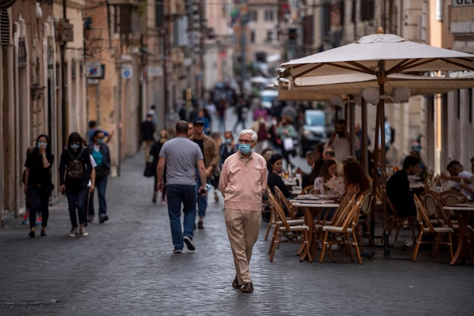 ROME, ITALY - OCTOBER 02: People wearing protective masks walk around the Piazza di Spagna amid Covid-19 pandemic, on October 02, 2020 in Rome, Italy. The Lazio region President Nicola Zingaretti set an order obliging people to wear face masks in public including outdoors due to the increase of Covid-19 cases in the Lazio region. (Photo by Antonio Masiello/Getty Images) (Photo: Antonio Masiello via Getty Images)