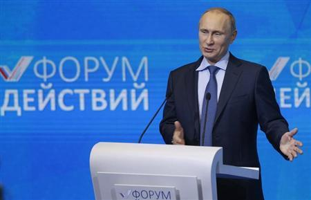 Russian President Vladimir Putin addresses the audience during a meeting with members of the All-Russian People's Front group in Moscow