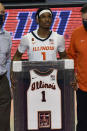 Illinois guard Trent Frazier receives his framed jersey before his last home NCAA college basketball game, against Nebraska on Thursday, Feb. 25, 2021, in Champaign, Ill. (AP Photo/Holly Hart)