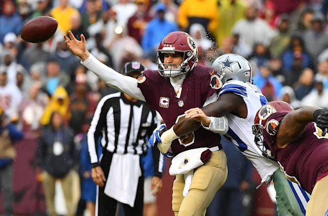 <p>Washington Redskins quarterback Kirk Cousins (8) is pressured by Dallas Cowboys defensive end Demarcus Lawrence (90) during the first half at FedEx Field. Mandatory Credit: Brad Mills-USA TODAY Sports </p>