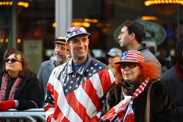 <p>Spectators show patriotism as veterans march during the Veterans Day parade on Fifth Avenue in New York on Nov. 11, 2017. (Photo: Gordon Donovan/Yahoo News) </p>