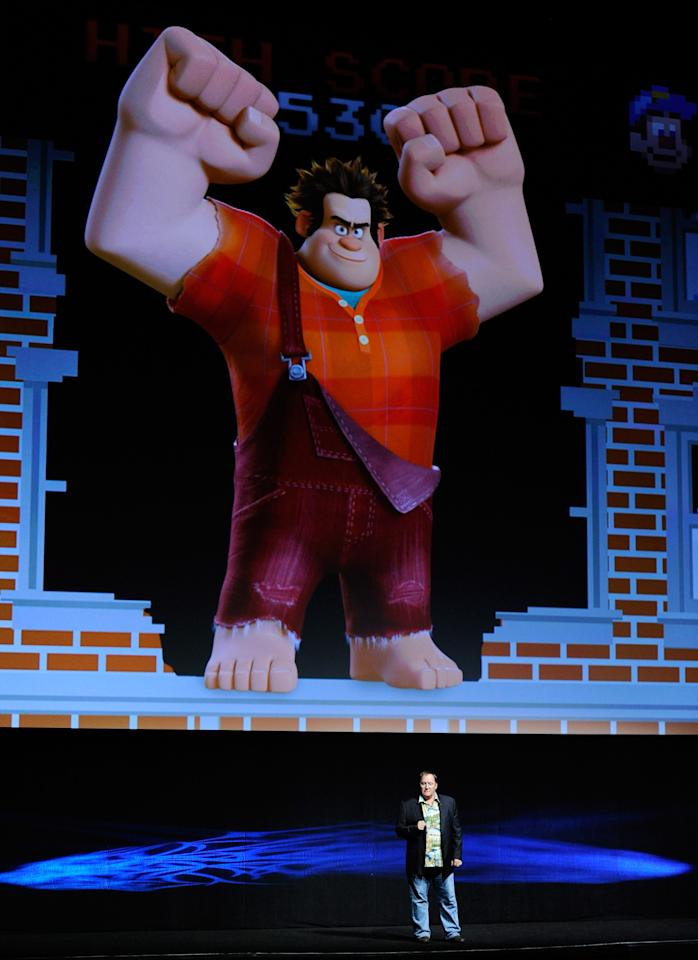 """LAS VEGAS, NV - APRIL 24:  Chief Creation Officer of Pixar Animation Studios John Lasseter speaks at a Walt Disney Studios Motion Pictures presentation to promote the upcoming animated film, """"Wreck-It Ralph"""" at The Colosseum at Caesars Palace during CinemaCon, the official convention of the National Association of Theatre Owners, April 24, 2012 in Las Vegas, Nevada.  (Photo by Ethan Miller/Getty Images)"""