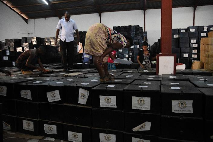 Volunteers check to make sure ballot boxes are intact on February 15, 2016, at an Electoral Commission warehouse in Kampala (AFP Photo/Isaac Kasamani)