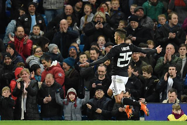 Argentina 2 Italy 0: West Ham's Manuel Lanzini scores his first goal for his country to cap victory in Manchester