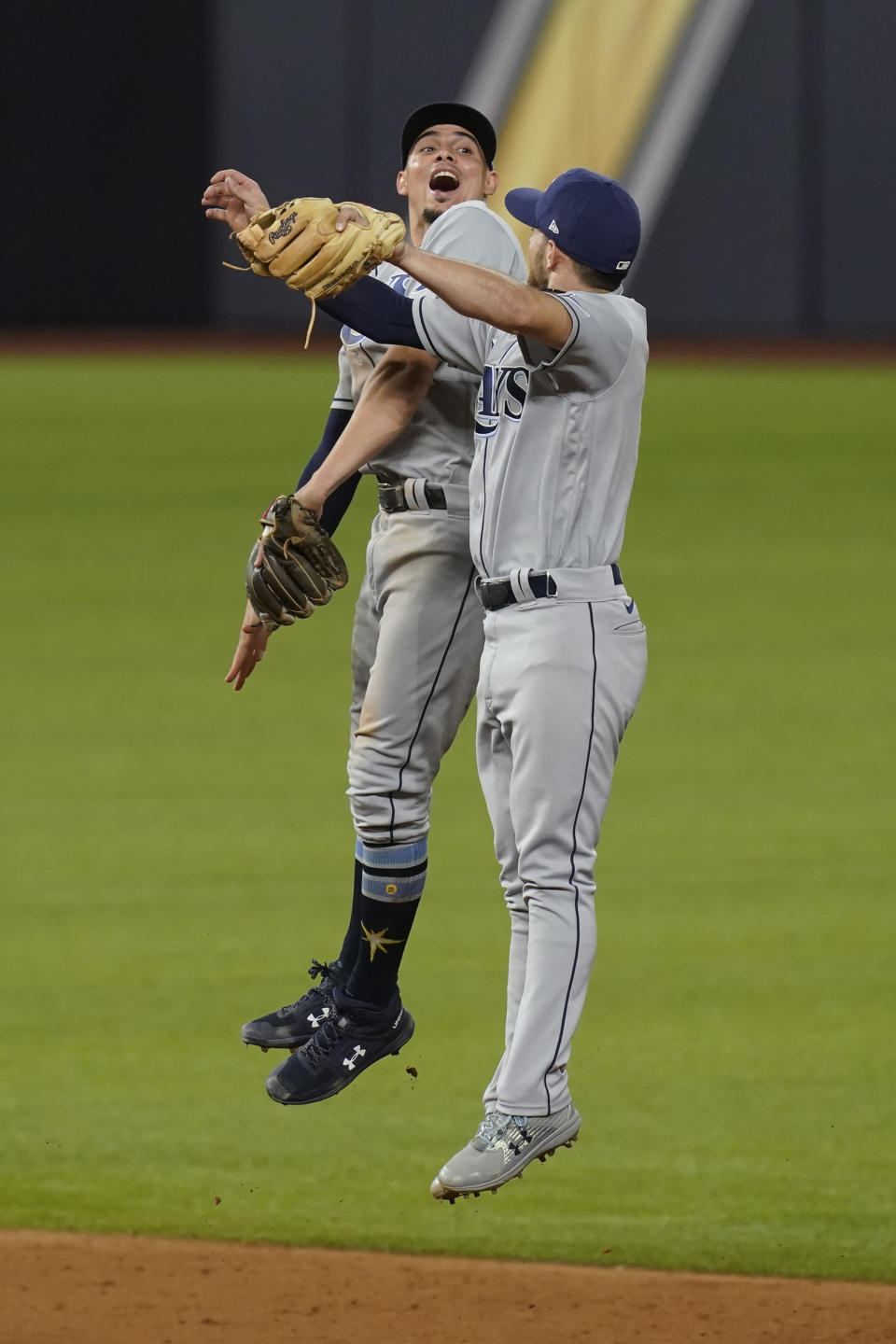 Tampa Bay Rays shortstop Willy Adames and second baseman Brandon Lowe celebrate their win in Game 2 of the baseball World Series against the Los Angeles Dodgers Wednesday, Oct. 21, 2020, in Arlington, Texas. Ray beat the Dodgers 6-4.(AP Photo/Eric Gay)