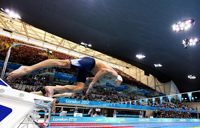 United States swimmer Michael Phelps dives off of the starting block during the men's 400-meter individual medley event during the 2012 Summer Olympics at the Aquatics Centre in London on Saturday, July 28, 2012, in London. (AP Photo/Al Bello, Pool)