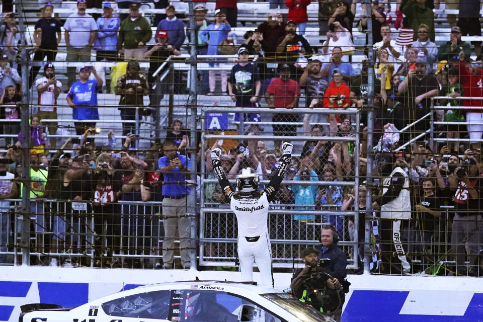 Aric Almirola celebrates after winning the NASCAR Cup Series auto race Sunday, July 18, 2021, in Loudon, N.H. (AP Photo/Charles Krupa)
