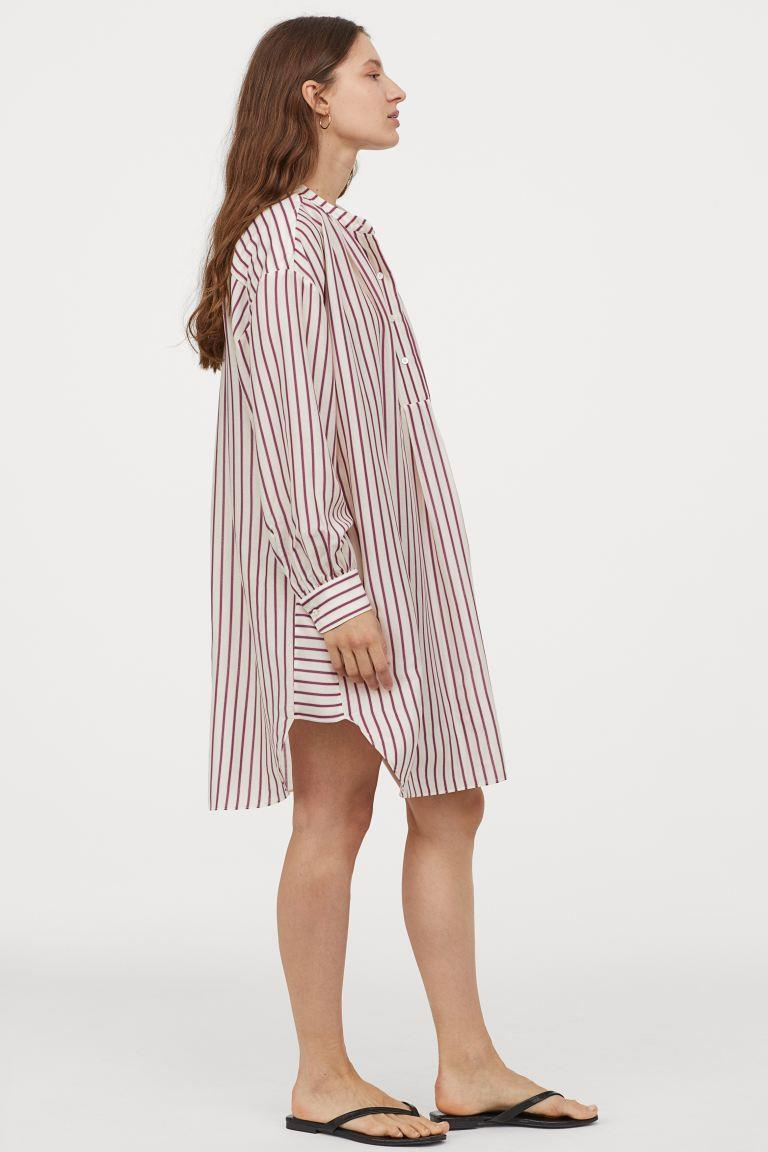 "<h2>H&M Silk Blend Tunic</h2> <br>""While my loyalty to the traditionally-styled button-down will never waver, I'm in the market for a new iteration, which is why this standing-collar tunic caught my eye. Its oversize silhouette makes it a very airy, summer-friendly piece, and it helps me feel somewhat put together when I throw it over yesterday's leggings or kick-flare jeans when I'm running out for coffee in the morning."" <em>– Emily Ruane, Fashion Market Writer</em><br><br><em>Shop <strong><a href=""https://www2.hm.com/"" rel=""nofollow noopener"" target=""_blank"" data-ylk=""slk:H&M"" class=""link rapid-noclick-resp"">H&M</a></strong></em><br><br><strong>H&M</strong> Silk-blend Striped Tunic, $, available at <a href=""https://go.skimresources.com/?id=30283X879131&url=https%3A%2F%2Fwww2.hm.com%2Fen_us%2Fproductpage.0863764002.html"" rel=""nofollow noopener"" target=""_blank"" data-ylk=""slk:H&M"" class=""link rapid-noclick-resp"">H&M</a><br><br><br>"