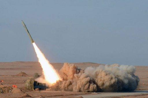 Iran test-fires its short-range Fateh missile during the second day of military exercises at an undisclosed location in Iran's Kavir Desert. Iran has test-fired a ballistic missile capable of striking Israel as part of war games designed to show its ability to retaliate if attacked, media said