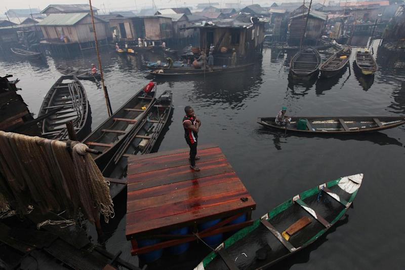 A man stands on the dock of a proposed floating school at the floating slum in Makoko in Lagos, Nigeria, Thursday, Sept. 27, 2012. A group is planning to build a floating school in the slum, which state authorities have targeted for demolition in the past. (AP Photo/Sunday Alamba)
