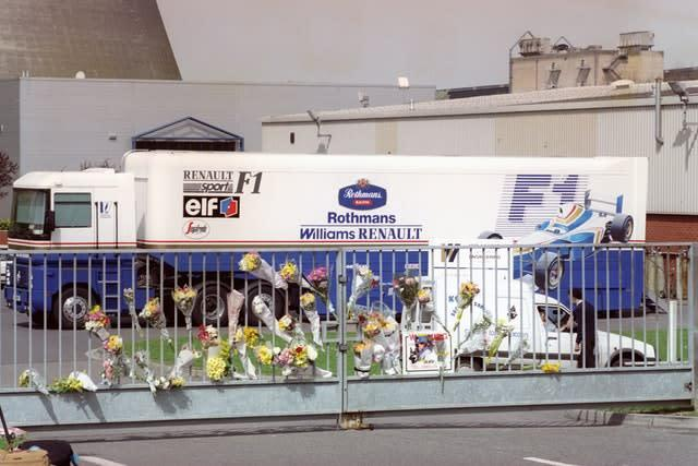 Floral tributes at the gate of the Williams Renault headquarters at Didcot, Oxfordshire, after the death of Senna on May 1, 1994 (Adam Butler/PA)