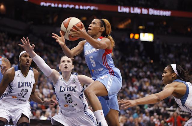 Atlanta Dream guard Jasmine Thomas (5) pushes up to the basket against Minnesota Lynx guard Lindsay Whalen (13) during Game 1 of the WNBA basketball Finals, Sunday, Oct. 6, 2013, in Minneapolis. (AP Photo/Stacy Bengs)