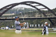 Lee Westwood, of England, hits his second shot on the 13th hole during a first round match at the Dell Technologies Match Play Championship golf tournament Wednesday, March 24, 2021, in Austin, Texas. (AP Photo/David J. Phillip)