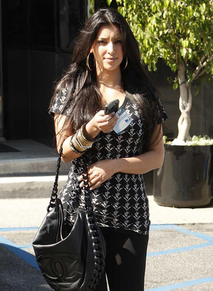 """On Thursday, reality star Kim Kardashian denied claims that she cheated on boyfriend Reggie Bush with Travis Barker. The accusations were made by Travis' ex-wife Shanna Moakler. Kim had fanned the flames by wearing a shirt from Travis' Stars and Straps clothing collection on Monday (see above), but later called her fashion choice """"immature."""" In another twist, Kim is rumored to be joining the cast of """"Dancing With the Stars,"""" which Shanna appeared on in Season 3. <a href=""""http://www.infdaily.com"""" target=""""new"""">INFDaily.com</a> - July 24, 2008"""