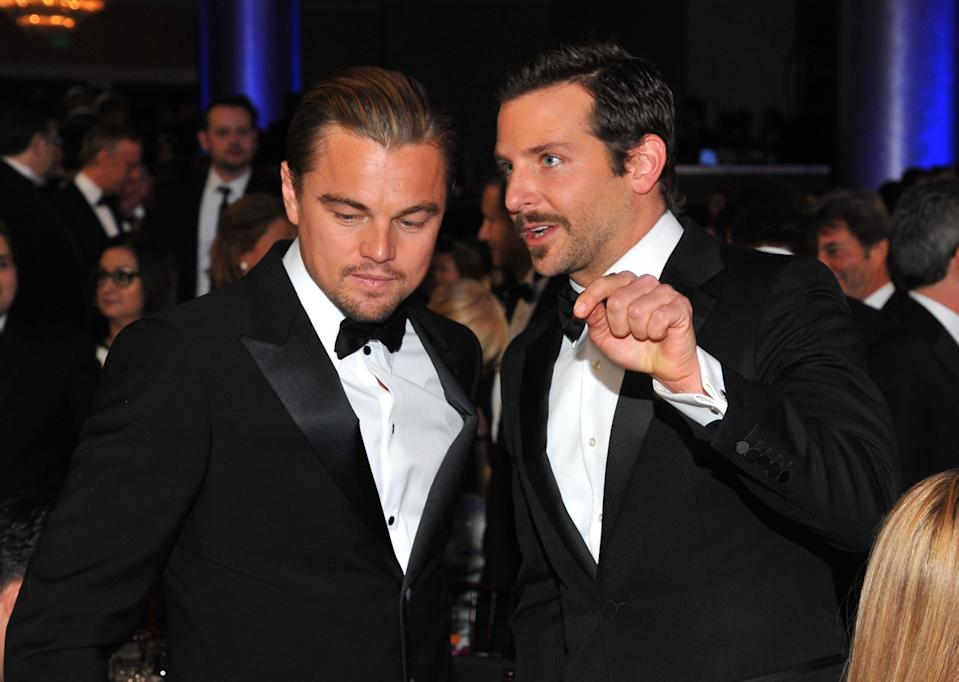 69th ANNUAL GOLDEN GLOBE AWARDS -- Pictured: (l-r) Leonardo DiCaprio, Bradley Cooper during the 69th Annual Golden Globe Awards held at the Beverly Hilton Hotel on January 15, 2012  (Photo by Vince Bucci/NBC/NBCU Photo Bank via Getty Images)
