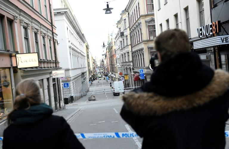 "Four people were killed and 15 others injured when a stolen truck slammed into a crowd of people outside a busy department store in central Stockholm, in what the prime minister described as a ""terror attack"""