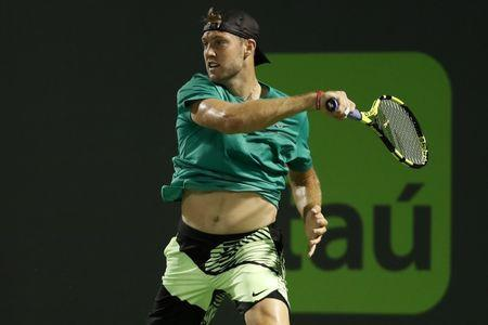 Mar 29, 2017; Miami, FL, USA; Jack Sock of the United States hits a forehand against Rafael Nadal of Spain (not pictured) on day nine of the 2017 Miami Open at Crandon Park Tennis Center. Nadal won 6-2, 6-3. Mandatory Credit: Geoff Burke-USA TODAY Sports