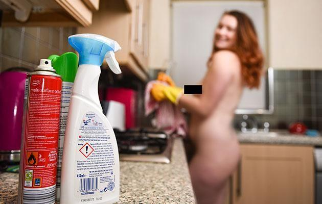 Emily Nikols scrubs kitchens naked. Source: Caters News