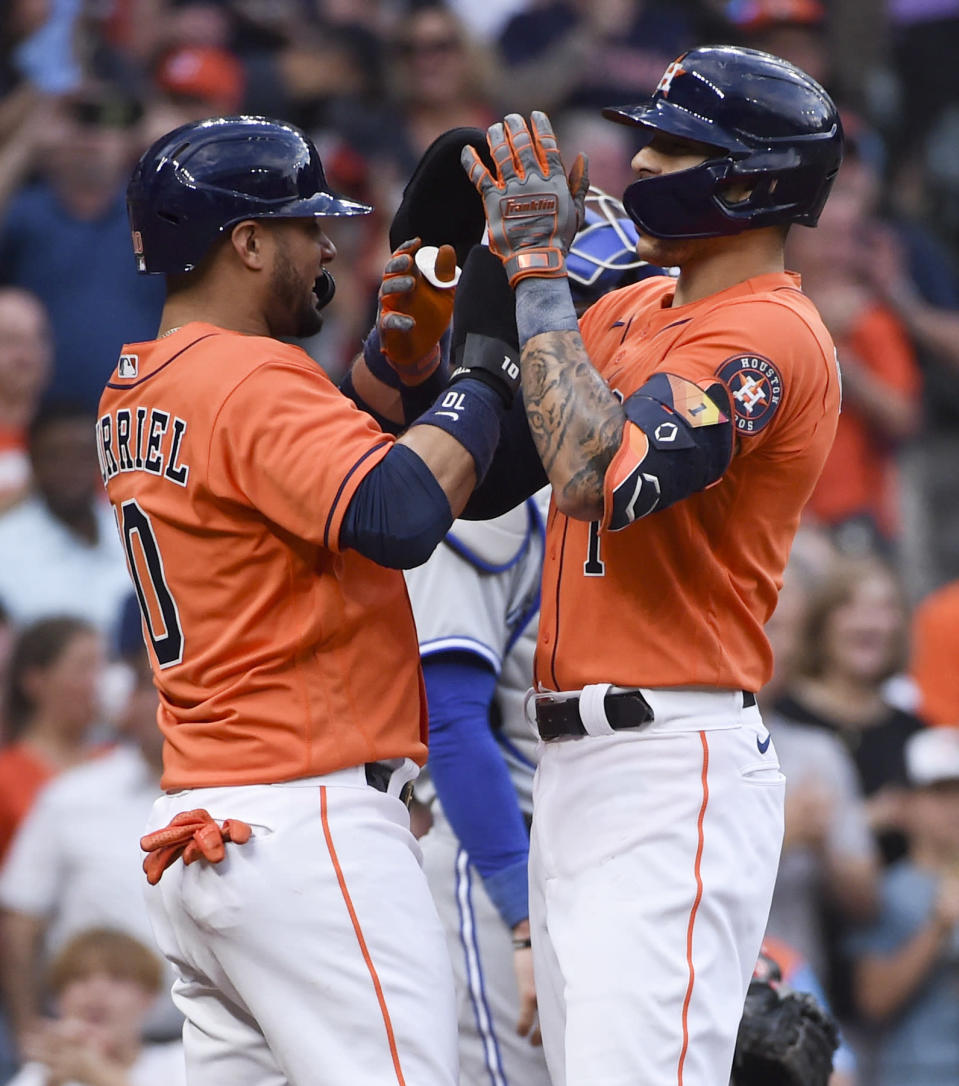 Houston Astros' Carlos Correa, right, celebrates his two-run home run with Yuli Gurriel during the second inning of baseball game against the Toronto Blue Jays, Friday, May 7, 2021, in Houston. (AP Photo/Eric Christian Smith)