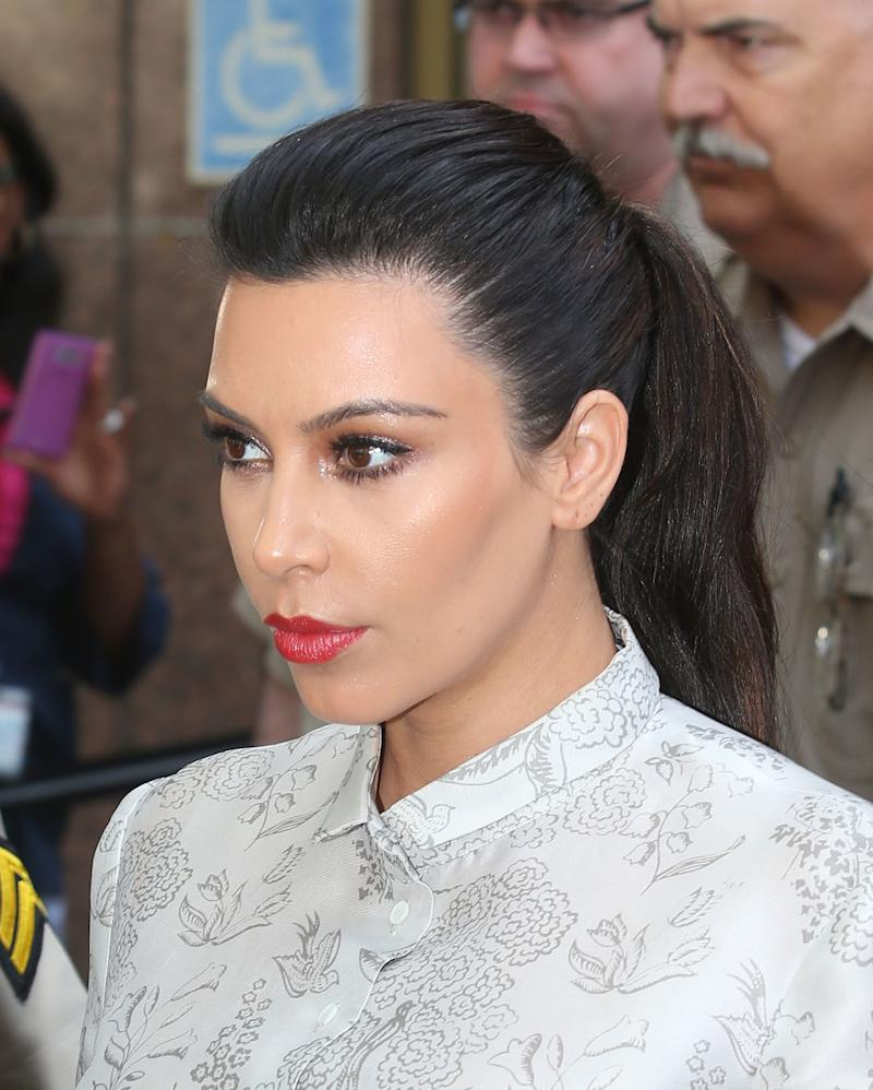 LOS ANGELES, CA - APRIL 12: Kim Kardashian surrounded by Los Angeles County Sheriff Deputies leaves the Stanley Mosk Courthouse after attending her divorce hearing from Kris Humphries on April 12, 2013 in Los Angeles, California. Kim Kardashian and NBA player Kris Humphries are appearing for divorce proceedings. Humphries is seeking an annulment of their ten-week marriage, claiming it was based on fraud. (Photo by Frederick M. Brown/Getty Images)