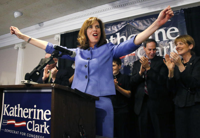Democrat Katherine Clark reacts to supporters as her husband, Rod, and Massachusetts Attorney General Martha Coakley applaud, background right, at her election night party in Stoneham, Mass., Tuesday, Dec. 10, 2013, where she claimed victory in a special election for the vacated seat in Massachusetts' 5th Congressional District. The seat was left vacant by Edward Markey, who resigned after winning a special election to fill John Kerry's U.S. Senate seat after he had stepped down to become secretary of state. Clark defeated Republican Frank Addivinola, a Boston attorney. (AP Photo/Elise Amendola)