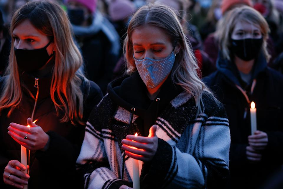 LONDON, UNITED KINGDOM - MARCH 13: Mourners for the life of murdered 33-year-old Sarah Everard, whose remains were found this week in woodland in Kent, take part in an officially cancelled 'Reclaim These Streets' vigil on Clapham Common in London, United Kingdom on March 13, 2021. Wayne Couzens, a serving Metropolitan Police officer, was yesterday charged with the kidnap and murder of Everard, who went missing over a week ago from south London and whose disappearance and death has seen women across the country speaking up about their own fears of not being safe on the streets. (Photo by David Cliff/Anadolu Agency via Getty Images)