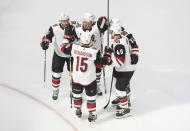 Arizona Coyotes celebrate a goal against the Colorado Avalanche during the second period of a first round NHL Stanley Cup playoff hockey series in Edmonton, Alberta, Friday, Aug. 14, 2020. (Jason Franson/The Canadian Press via AP)
