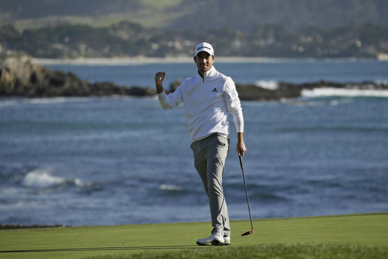 Nick Taylor, of Canada, reacts on the 18th green of the Pebble Beach Golf Links after winning the AT&T Pebble Beach National Pro-Am golf tournament Sunday, Feb. 9, 2020, in Pebble Beach, Calif. (AP Photo/Eric Risberg)
