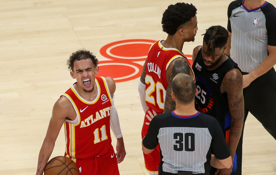 Trae Young hyped with Reggie Bullock in background Game 3