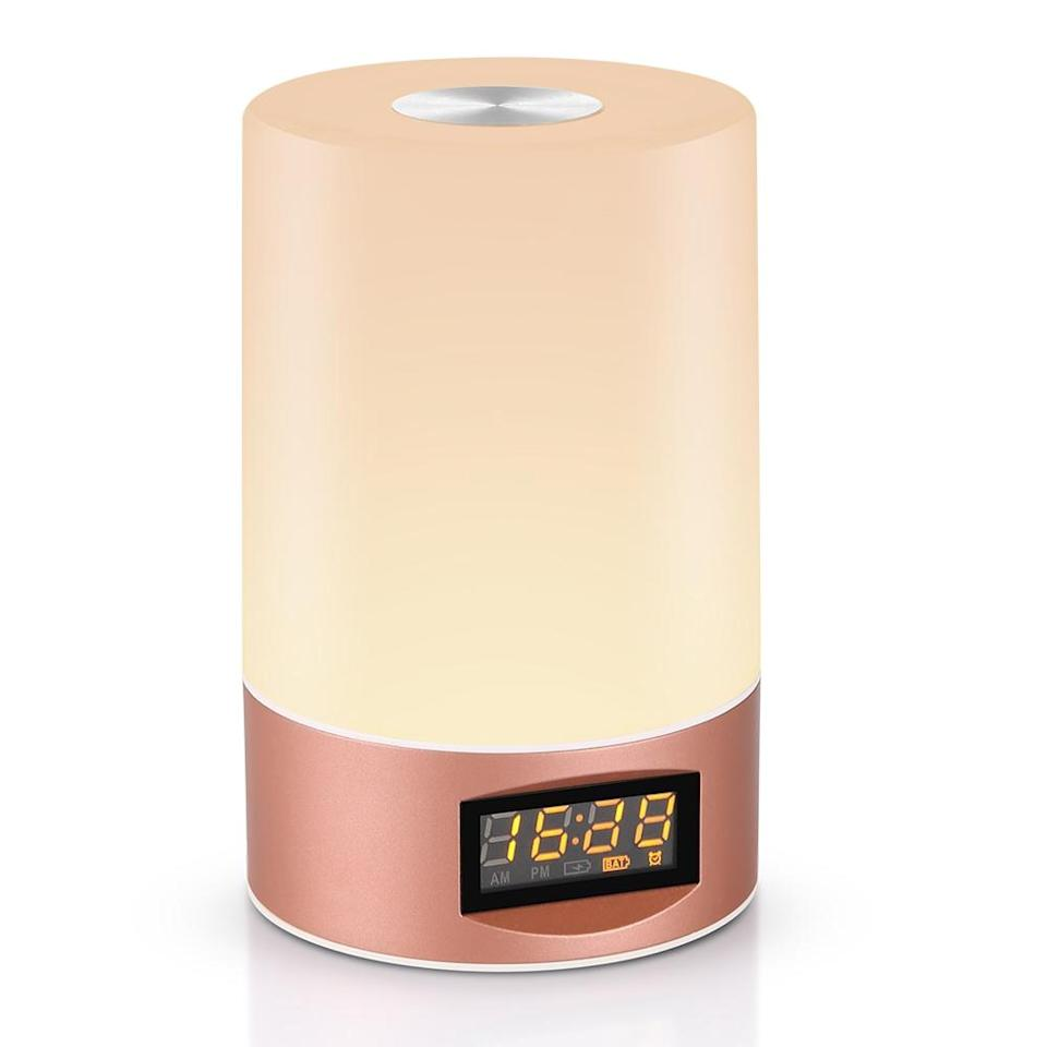 """<strong><h3><a href=""""https://www.gearbest.com/table-lamps/pp_009387758048.html"""" rel=""""nofollow noopener"""" target=""""_blank"""" data-ylk=""""slk:Utorch Wake-Up Light"""" class=""""link rapid-noclick-resp"""">Utorch Wake-Up Light</a></h3></strong><br>Reviewers tout this three-light wake-up clock with additional color transition and sound settings as a quality gift and stylish home accent."""