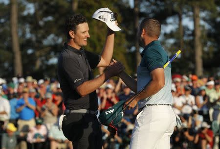 Justin Rose of England (L) and Sergio Garcia of Spain shake hands after finishing regulation play tied in the final round of the 2017 Masters golf tournament at Augusta National Golf Club in Augusta, Georgia, U.S., April 9, 2017. REUTERS/Mike Segar