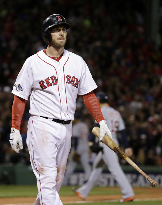 Boston Red Sox's Stephen Drew walks to the dugout after striking out against Detroit Tigers starting pitcher Anibal Sanchez, rear, to end the sixth inning with the bases loaded in Game 1 of the American League baseball championship series Saturday, Oct. 12, 2013, in Boston. (AP Photo/Charles Krupa)