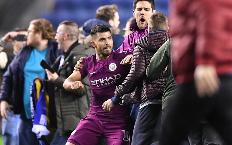 Sergio Aguero appeared to react following a confrontation with a pitch invader on Monday night - Getty Images Europe
