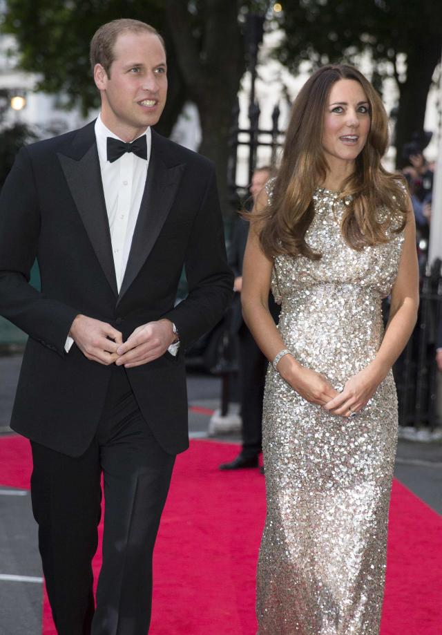 Britain's Prince William, the Duke of Cambridge, and his wife Catherine, the Duchess of Cambridge, arrive to attend the Tusk Conservation Awards at The Royal Society in London, September 12, 2013. REUTERS/Peter Nicholls/Pool (BRITAIN - Tags: ROYALS ENTERTAINMENT)