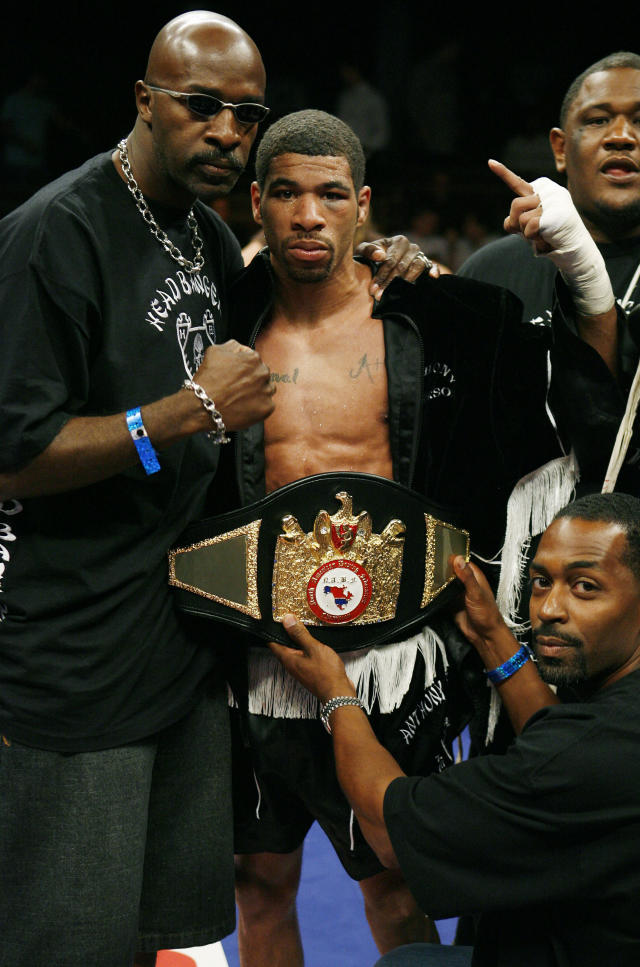 FILE - In this Aug. 2, 2008, file photo, Anthony Peterson celebrates his unanimous decision victory over Javier Jauregui, of Mexico, after their lightweight boxing match at The Palms Casino & Hotel in Las Vegas. Brothers Lamont and Anthony Peterson are each looking to prove themselves worthy of another title shot as they fight on the same card in front of their hometown fans. (AP Photo/Eric Jamison, File)