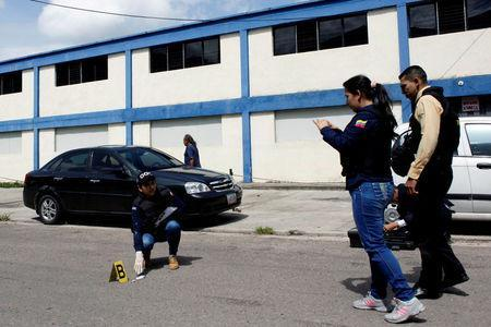 Police officers and criminal investigators inspect the area where a woman was shot when looters raided state food warehouses, in San Cristobal, Venezuela, June 6, 2016. REUTERS/Carlos Eduardo Ramirez