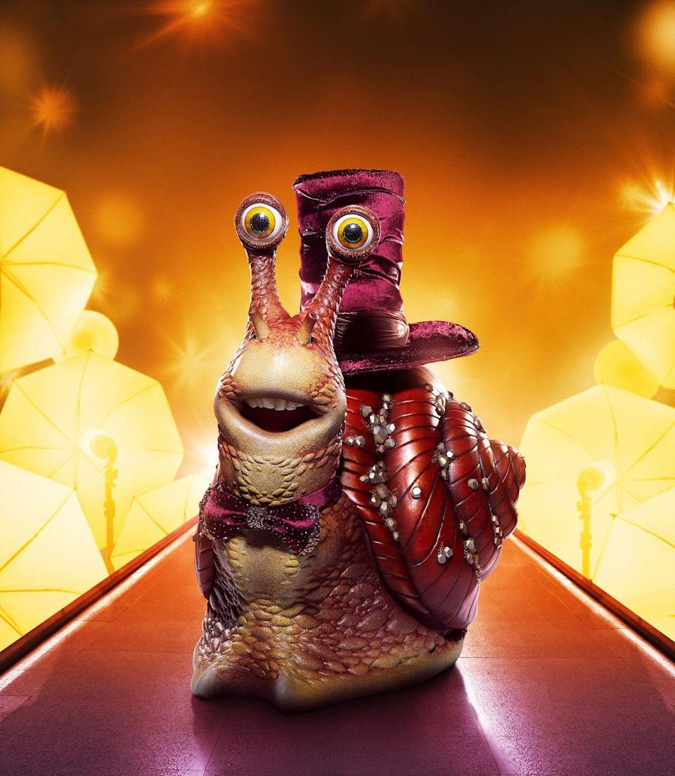 "<p><strong><em>The Masked Singer</em> revealed:</strong> Kermit the Frog</p><p><strong>Clues: </strong></p><p>1) Snail is considered ""a natural treasure.""</p><p>2) Snail has ""acted, directed, produced, recorded albums, even graced the Oscars stage. ""</p><p>3) Snail said, ""I've rubbed elbows with everyone from <strong>Robert De Niro</strong> to<strong> Lady Gaga</strong> to<strong> Michelle Obama</strong>."" </p><p><em>Read the internet's theories about Snail <a href=""https://www.goodhousekeeping.com/life/entertainment/a35796972/who-is-snail-on-the-masked-singer/"" rel=""nofollow noopener"" target=""_blank"" data-ylk=""slk:here"" class=""link rapid-noclick-resp"">here</a>.</em></p>"