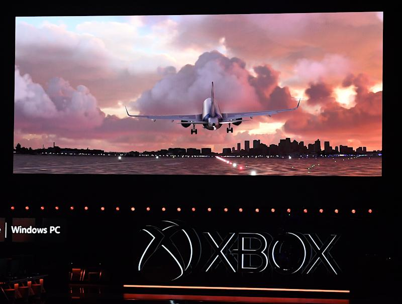 "(FILES) In this file photo taken on June 09, 2019 The video game ""Microsoft: Flight Simulator"" is promoted at the Microsoft Xbox press event ahead of the E3 gaming convention in Los Angeles on June 9, 2019. Many aircraft are still grounded due to the coronavirus pandemic. But would-be and real pilots will soon be able to travel anywhere in the world -- virtually -- thanks to the first update in years of Microsoft's Flight Simulator game. (Photo by Mark RALSTON / AFP)"