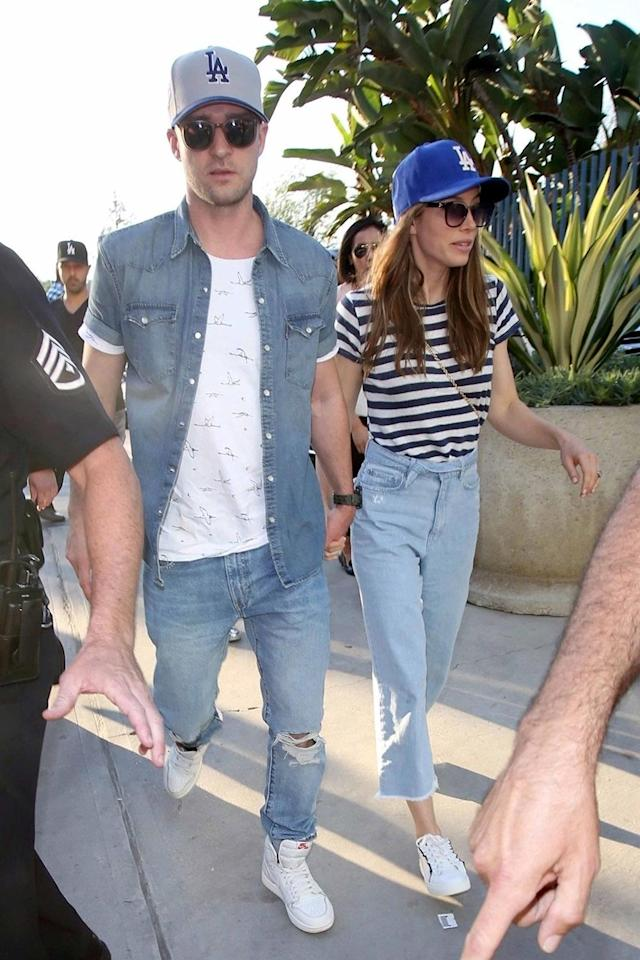 "<p>Denim and Dodgers hats helped Justin Timberlake and wife, Jessica Biel, blend in with the masses at the first game of the series. In fact, all that denim makes you wonder about whether it was JT's idea for <a href=""https://www.usmagazine.com/stylish/news/justin-timberlake-regrets-matching-denim-with-britney-spears-w452350/"" rel=""nofollow noopener"" target=""_blank"" data-ylk=""slk:that double-denim look"" class=""link rapid-noclick-resp""><span>that double-denim look</span></a><span> he and Britney Spears infamously rocked. (Photo: BACKGRID)</span> </p>"