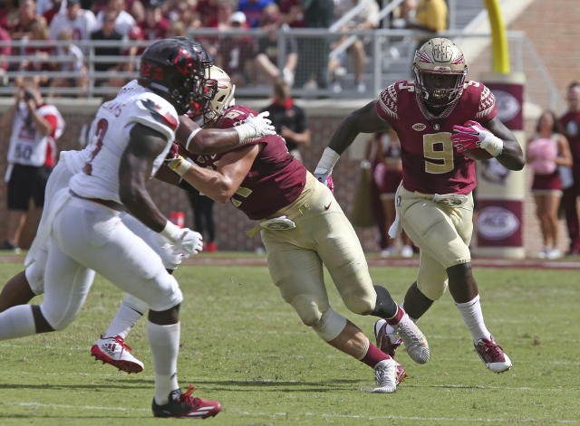 """Florida State's <a class=""""link rapid-noclick-resp"""" href=""""/ncaaf/players/251750/"""" data-ylk=""""slk:Jacques Patrick"""">Jacques Patrick</a> (R) rushed for 70 yards in the loss to Louisville. (AP Photo/Steve Cannon)"""